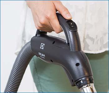 Dettaglio impugnatura con comando ON-OFF tubo flessibile Beam Progression